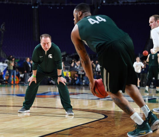 Michigan State Spartans head coach Tom Izzo watches forward Nick Ward (44) during practice for the 2019 men's Final Four at US Bank Stadium.