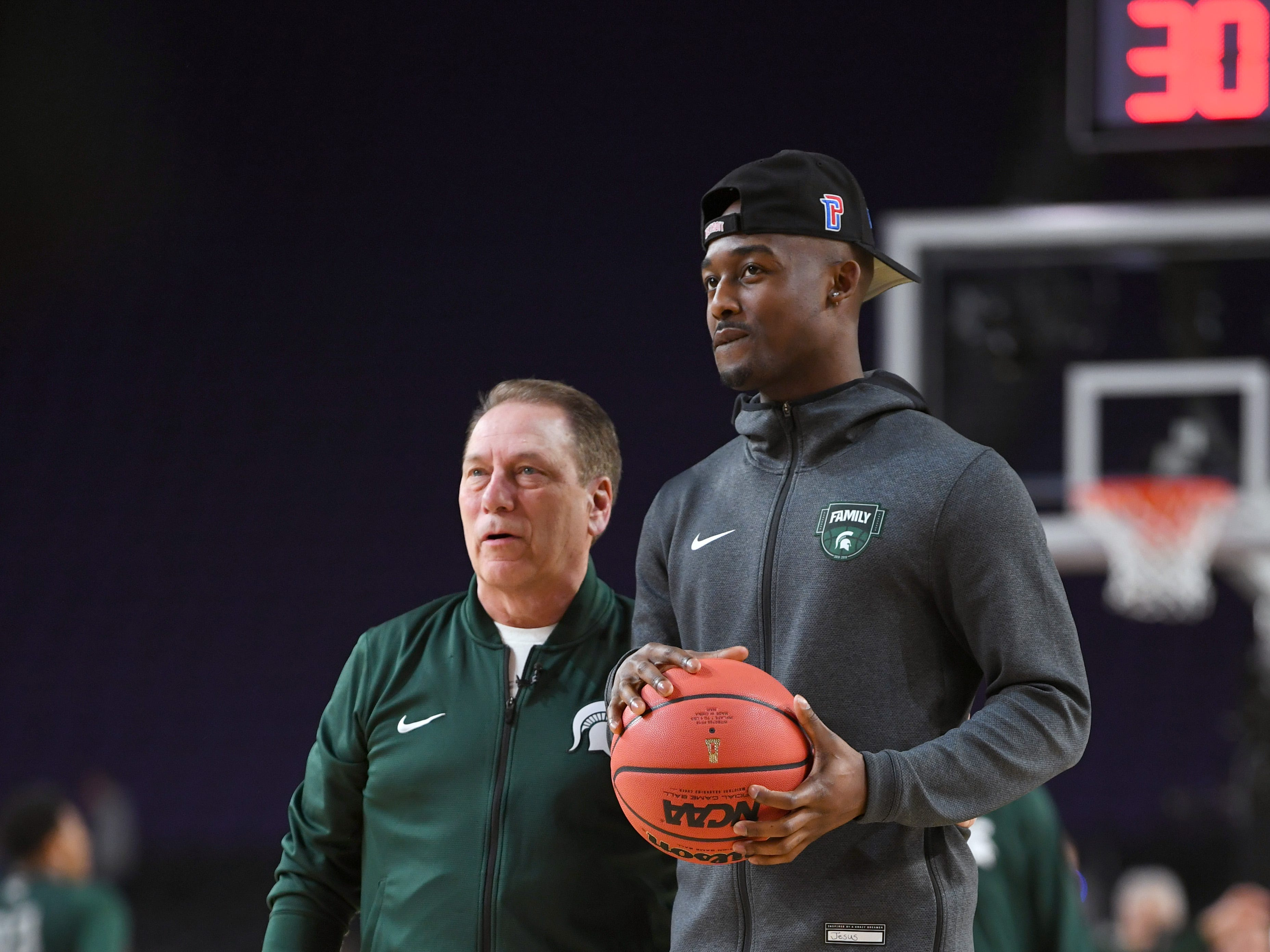 Apr 5, 2019; Minneapolis, MN, USA; Michigan State Spartans head coach Tom Izzo (left) and injured guard Joshua Langford (1) during practice for the 2019 men's Final Four at US Bank Stadium. Mandatory Credit: Bob Donnan-USA TODAY Sports