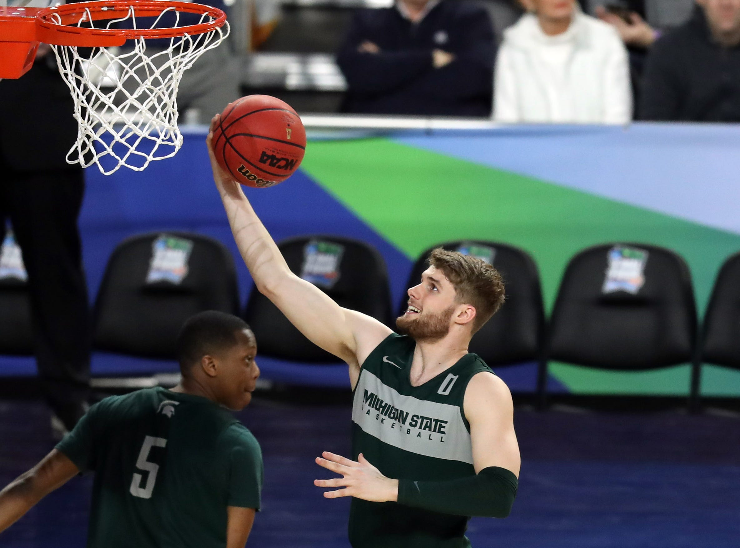 Apr 5, 2019; Minneapolis, MN, USA; Michigan State Spartans forward Kyle Ahrens (0) shoots the ball during practice for the 2019 men's Final Four at US Bank Stadium. Mandatory Credit: Brace Hemmelgarn-USA TODAY Sports
