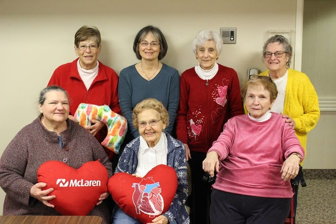 """Heart pillow volunteers"" - Back row left to right: Pam Jacob, Julie Herrick, Shirley Gagnon, Carolyn Jehner. Front row left to right: Berta Reynolds, Virginia Pfund, Marjorie Endriss."