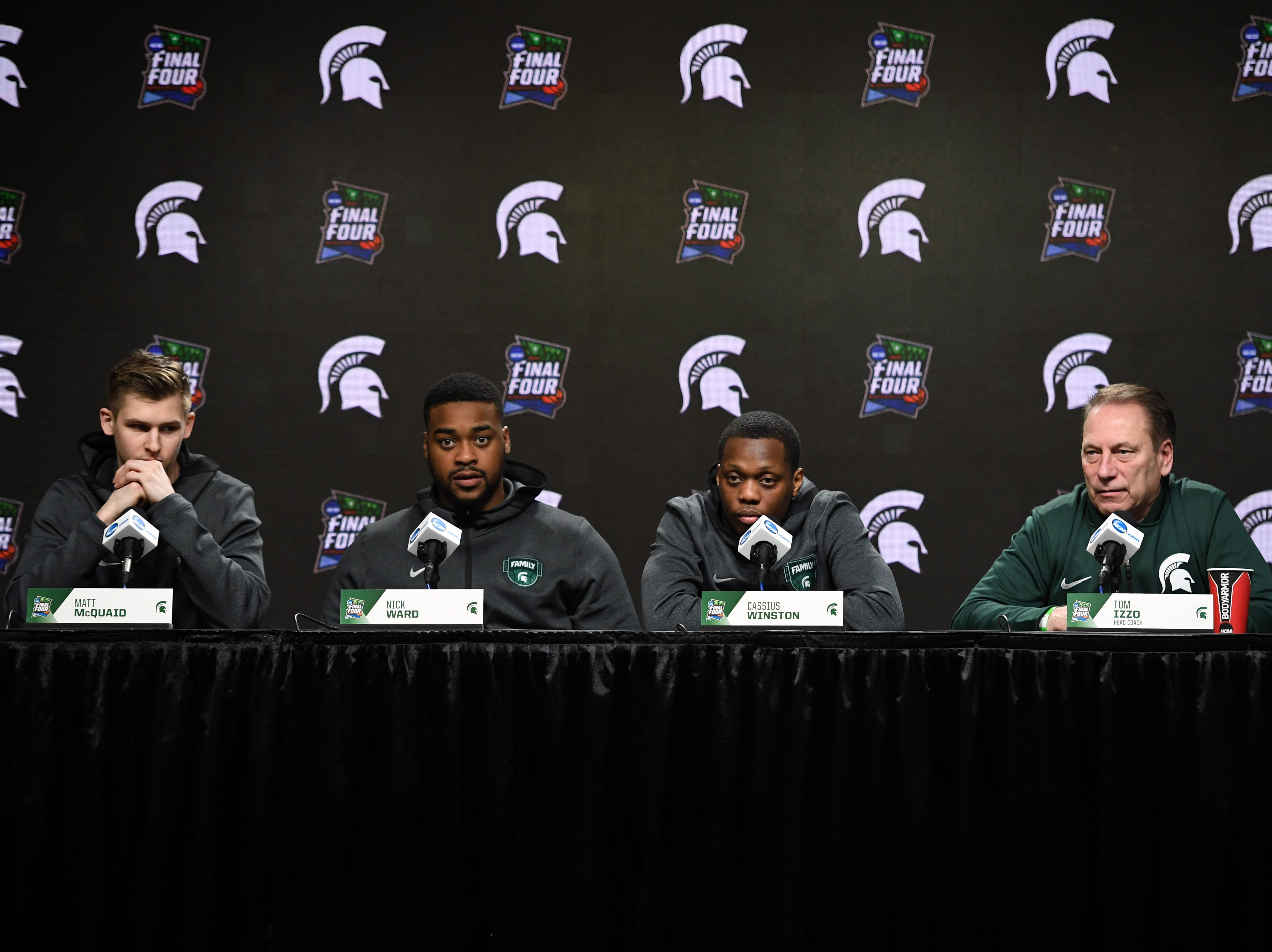 Apr 5, 2019; Minneapolis, MN, USA; Michigan State Spartans head coach Tom Izzo and guard Matt McQuaid (20) forward Nick Ward (44) and guard Cassius Winston (5) speaks during a press conference before practice for the 2019 men's Final Four at US Bank Stadium. Mandatory Credit: Shanna Lockwood-USA TODAY Sports