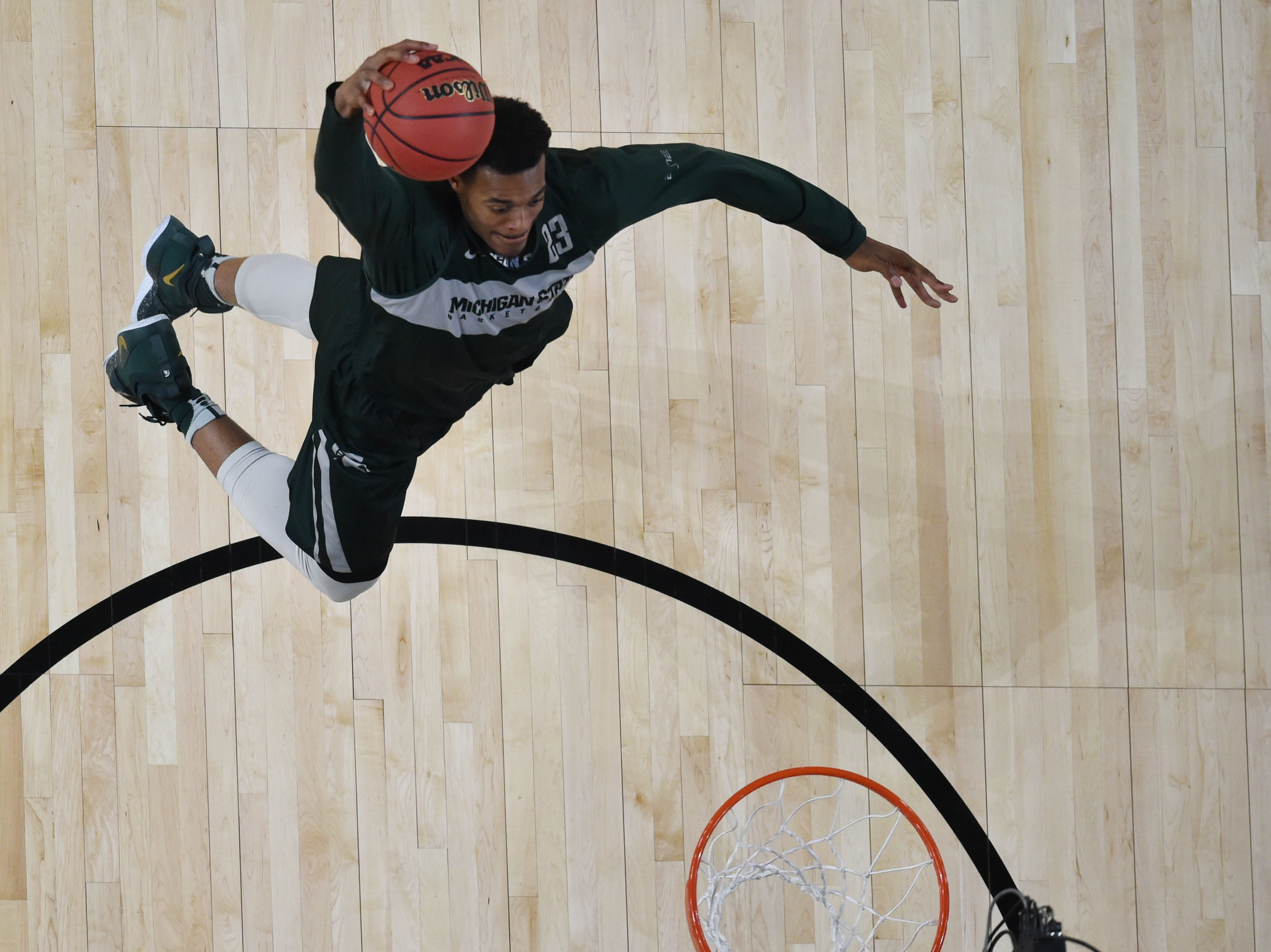 Apr 5, 2019; Minneapolis, MN, USA; Michigan State Spartans forward Xavier Tillman dunks the ball during practice for the 2019 men's Final Four at US Bank Stadium. Mandatory Credit: Robert Deutsch-USA TODAY Sports