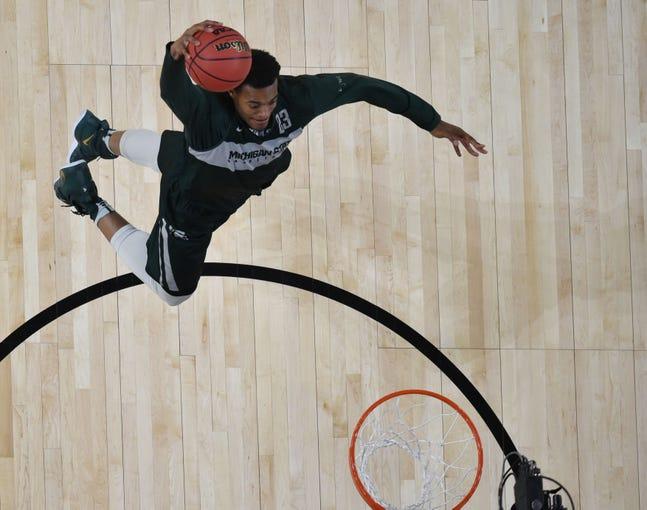 Apr 5, 2019; Minneapolis, MN, USA; Michigan State Spartans forward Xavier Tillman dunks the ball during practice for the 2019 men's Final Four at US Bank Stadium. Mandatory Credit: Robert Deutsch-USA TODAY Sports