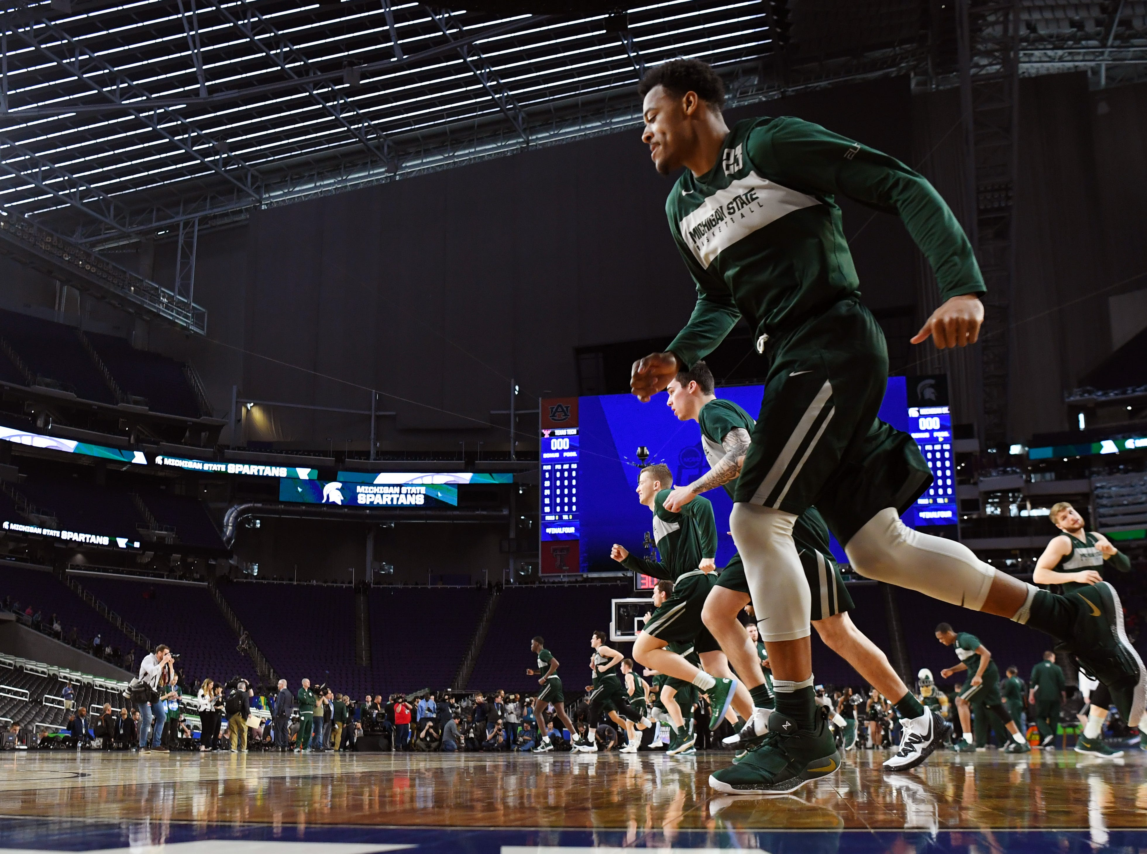 Apr 5, 2019; Minneapolis, MN, USA; Michigan State Spartans run a drill during practice for the 2019 men's Final Four at US Bank Stadium. Mandatory Credit: Bob Donnan-USA TODAY Sports