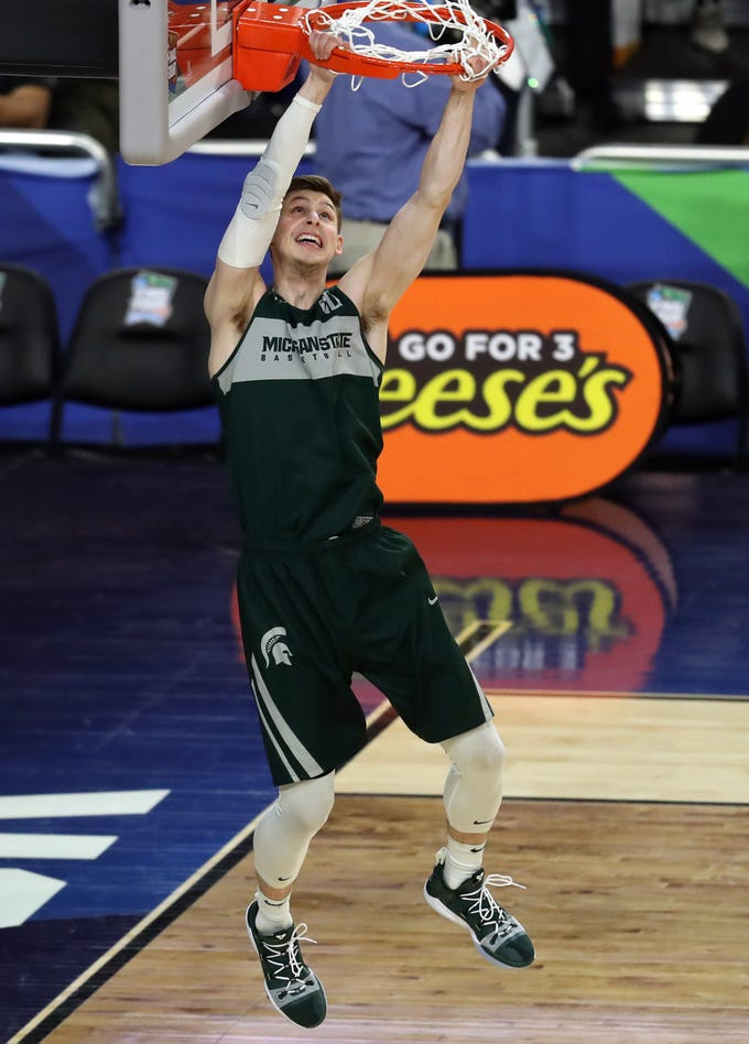 Apr 5, 2019; Minneapolis, MN, USA; Michigan State Spartans guard Matt McQuaid (20) dunks the ball during practice for the 2019 men's Final Four at US Bank Stadium. Mandatory Credit: Brace Hemmelgarn-USA TODAY Sports