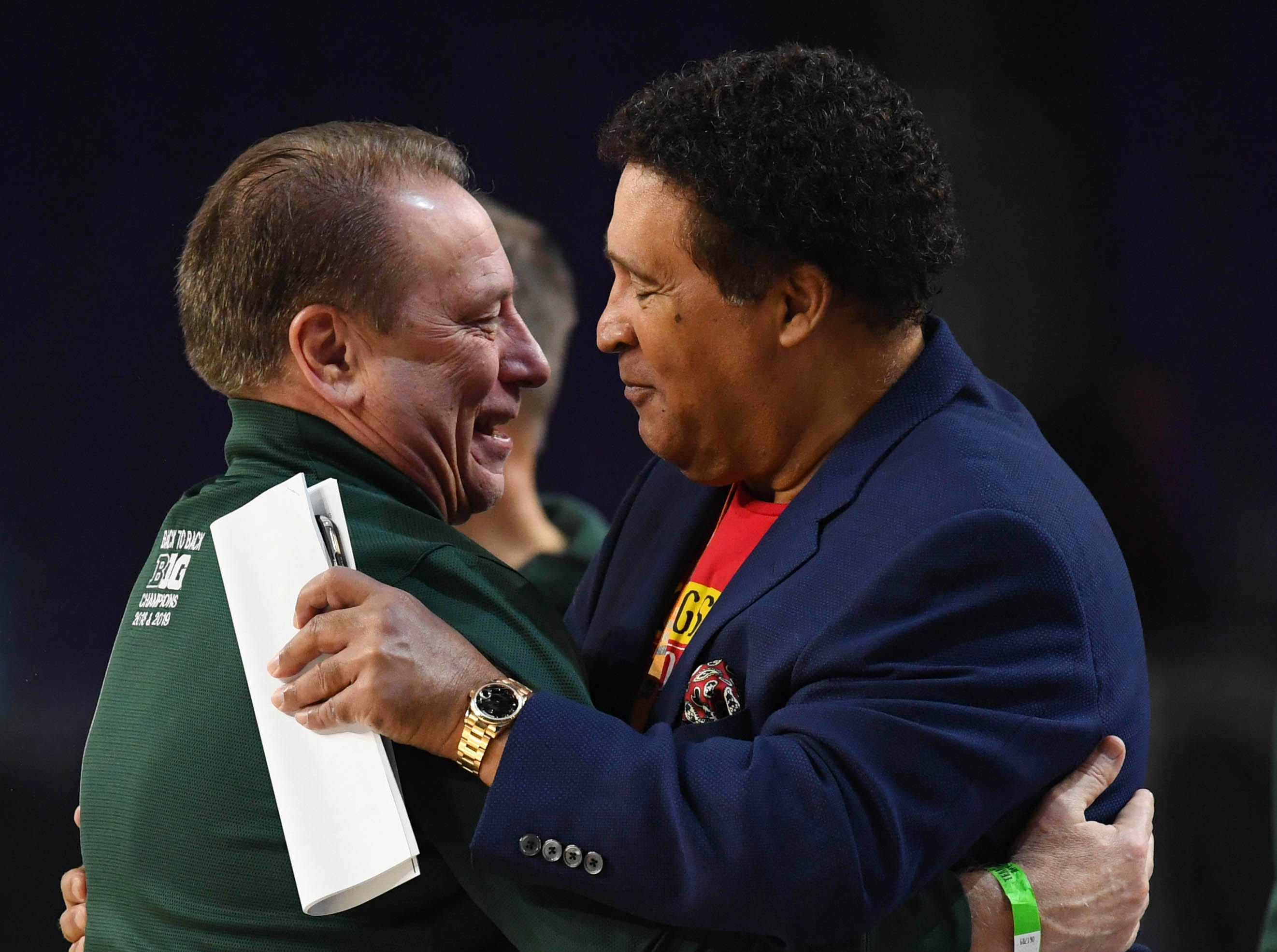 Apr 5, 2019; Minneapolis, MN, USA; Michigan State Spartans head coach Tom Izzo (left) greets CBS commentator Greg Gumbel during practice for the 2019 men's Final Four at US Bank Stadium. Mandatory Credit: Robert Deutsch-USA TODAY Sports