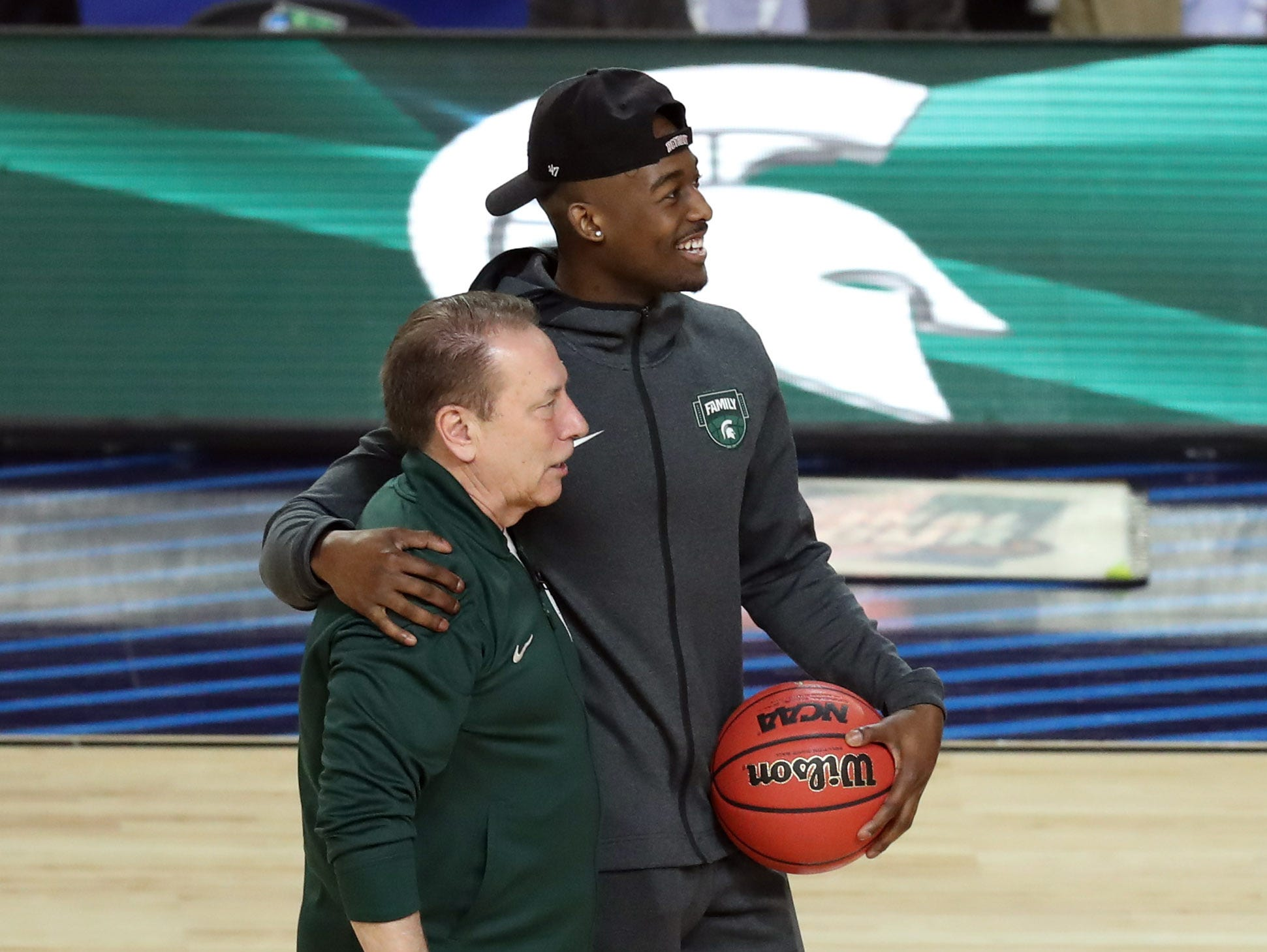 Apr 5, 2019; Minneapolis, MN, USA; Michigan State Spartans guard Joshua Langford (1) and head coach Tom Izzo embrace during practice for the 2019 men's Final Four at US Bank Stadium. Mandatory Credit: Brace Hemmelgarn-USA TODAY Sports