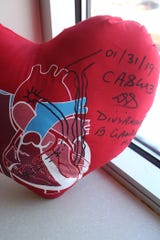 Heart pillow with markings from Dr. Gandhi.