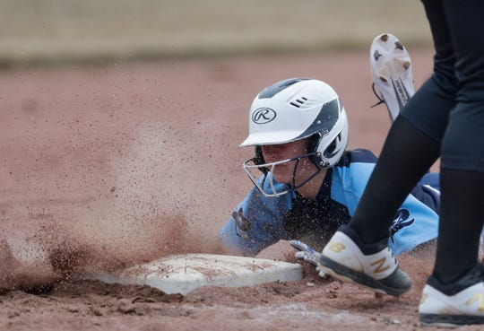 Roncalli's Maddie Hablewitz (4) slides into third against Two Rivers at Citizen Park Thursday in Manitowoc.