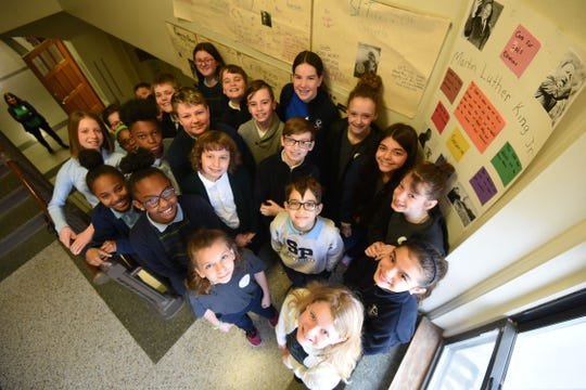 Fifth and sixth graders from St. Peter's Elementary School recently created posters illustrating civil rights leaders who have lived one or more of the seven Catholic Social Principles.
