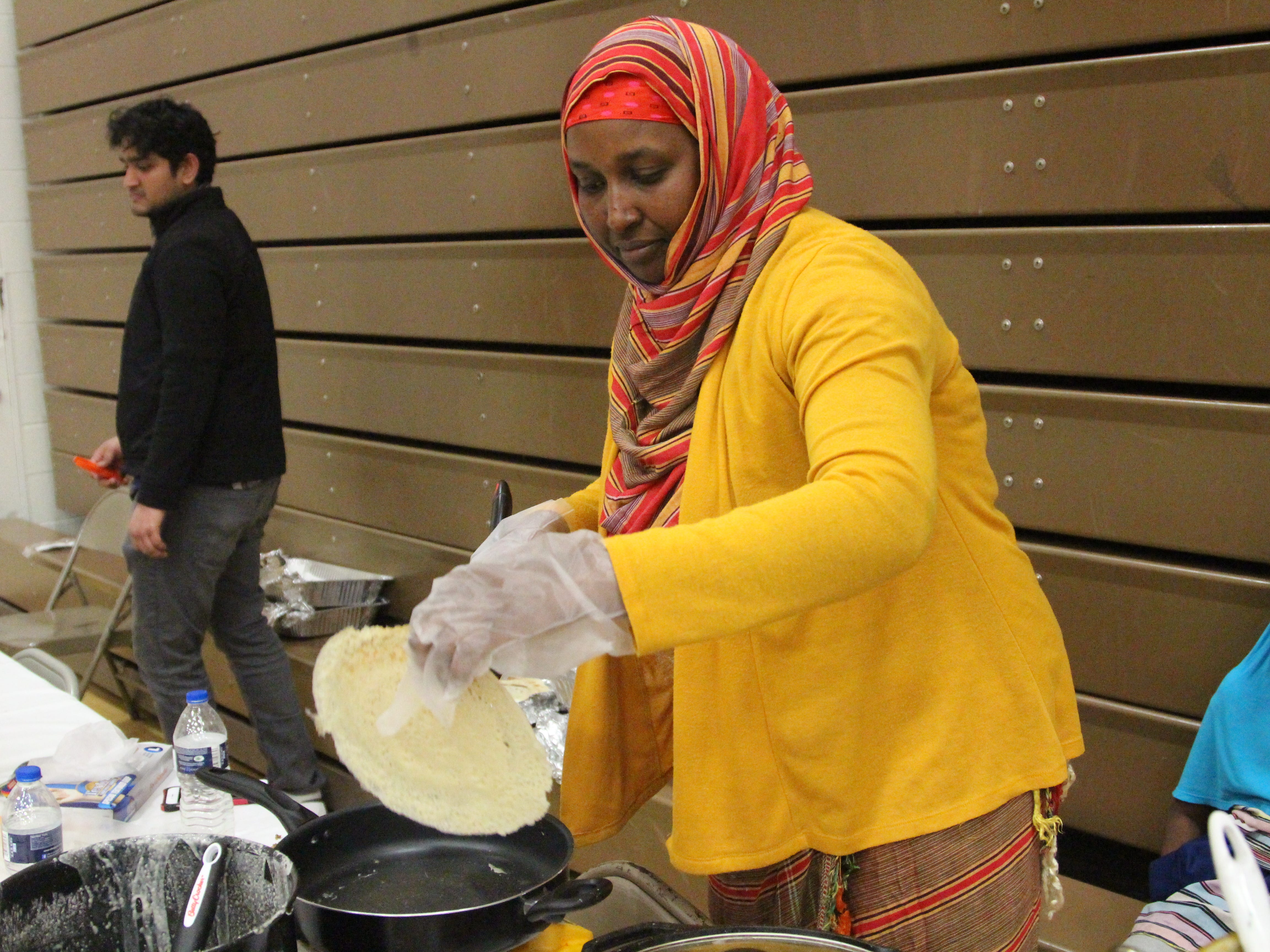 Nasra Abubakar, a lecturer in sociology at The Ohio State University at Marion, makes Somali bread, which she serves with a vegetable stew, Thursday at OSU-M's 12th Annual International Festival. She said the bread is typically eaten for breakfast, but can be served at dinnertime, too.