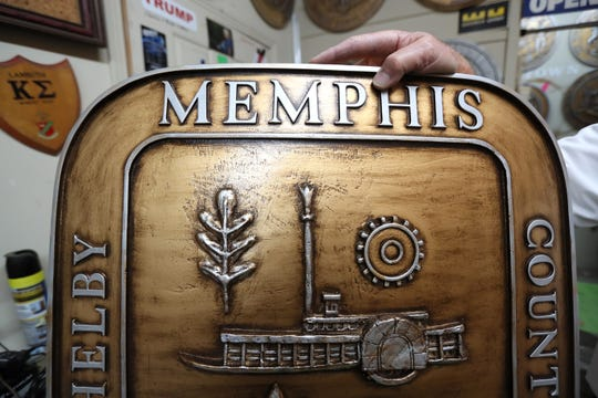 Robert Huff holds a Memphis City seal at his home on Wednesday, April 3, 2019 where he creates and sells a variety state, city and governmental seals from molds, something he has done for decades.