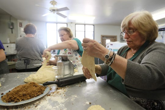 Despina Karas, right, and Linda Nichols weigh and roll dough as they help to produce hundreds of loaves of sweet bread in preparation for the Memphis Greek Festival at Annunciation Greek Orthodox Church on April 5.