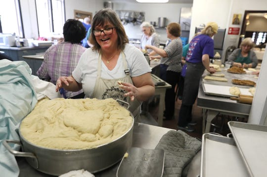 Marianthe Pilcher smiles as she works with dough to help bake hundreds of loaves of sweet bread in preparation for the Memphis Greek Festival at Annunciation Greek Orthodox Church on April 5.