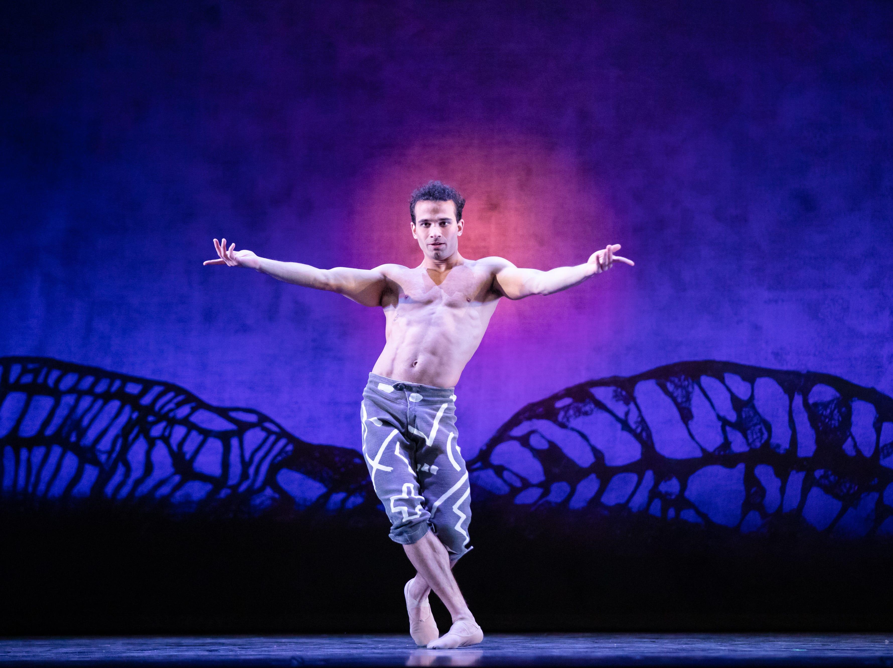 "Randy Crespo dances in Milwaukee Ballet's production of ""Lambarena."""