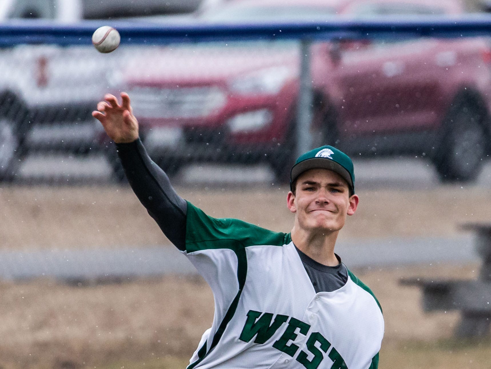 Wauwatosa West third baseman James Lee (2) fires a throw to first during the game at Brookfield Central on Thursday, April 4, 2019.