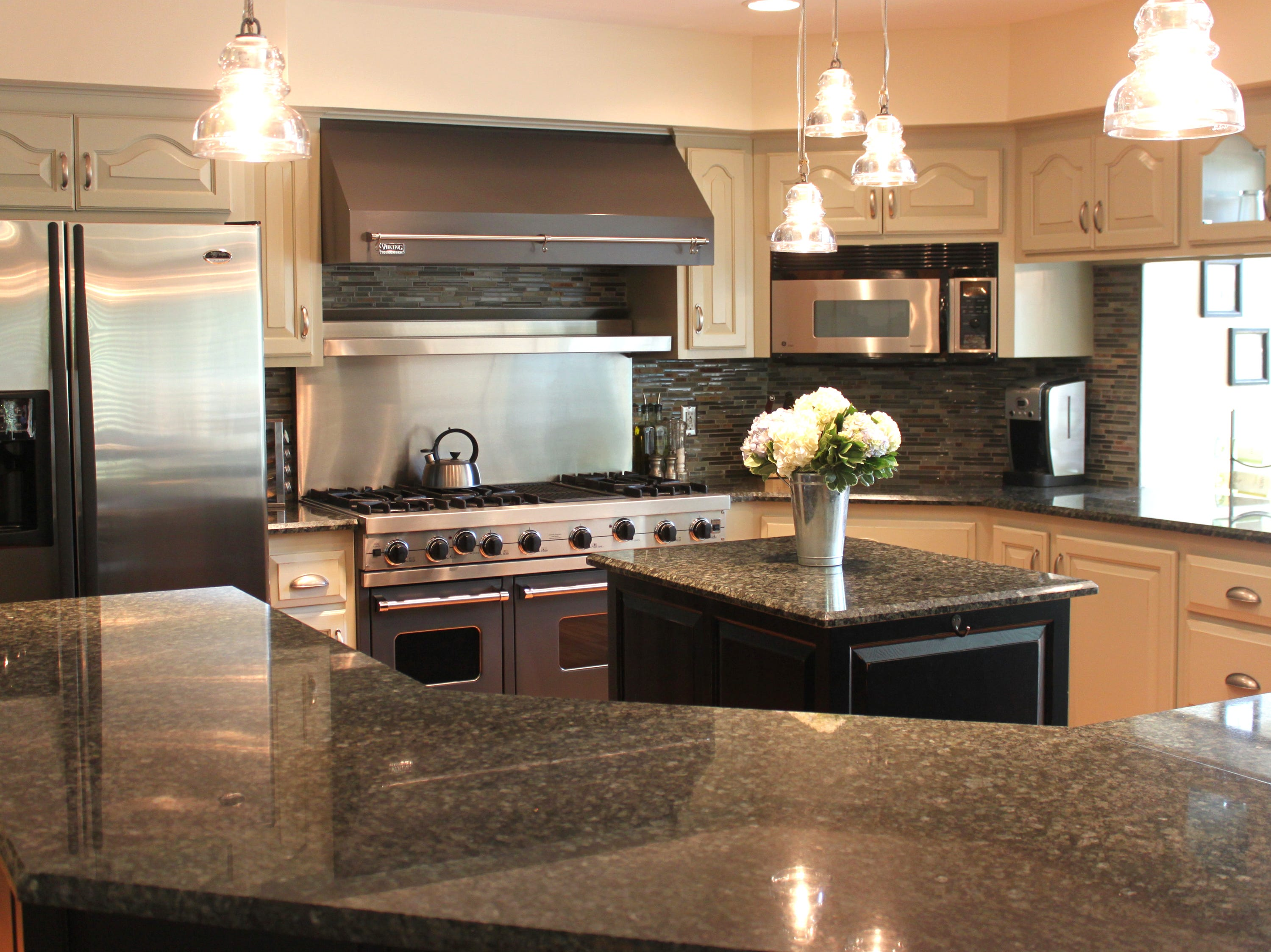 Sarah Timmer recently designed this kitchen update for a client, using pale sage cabinets.