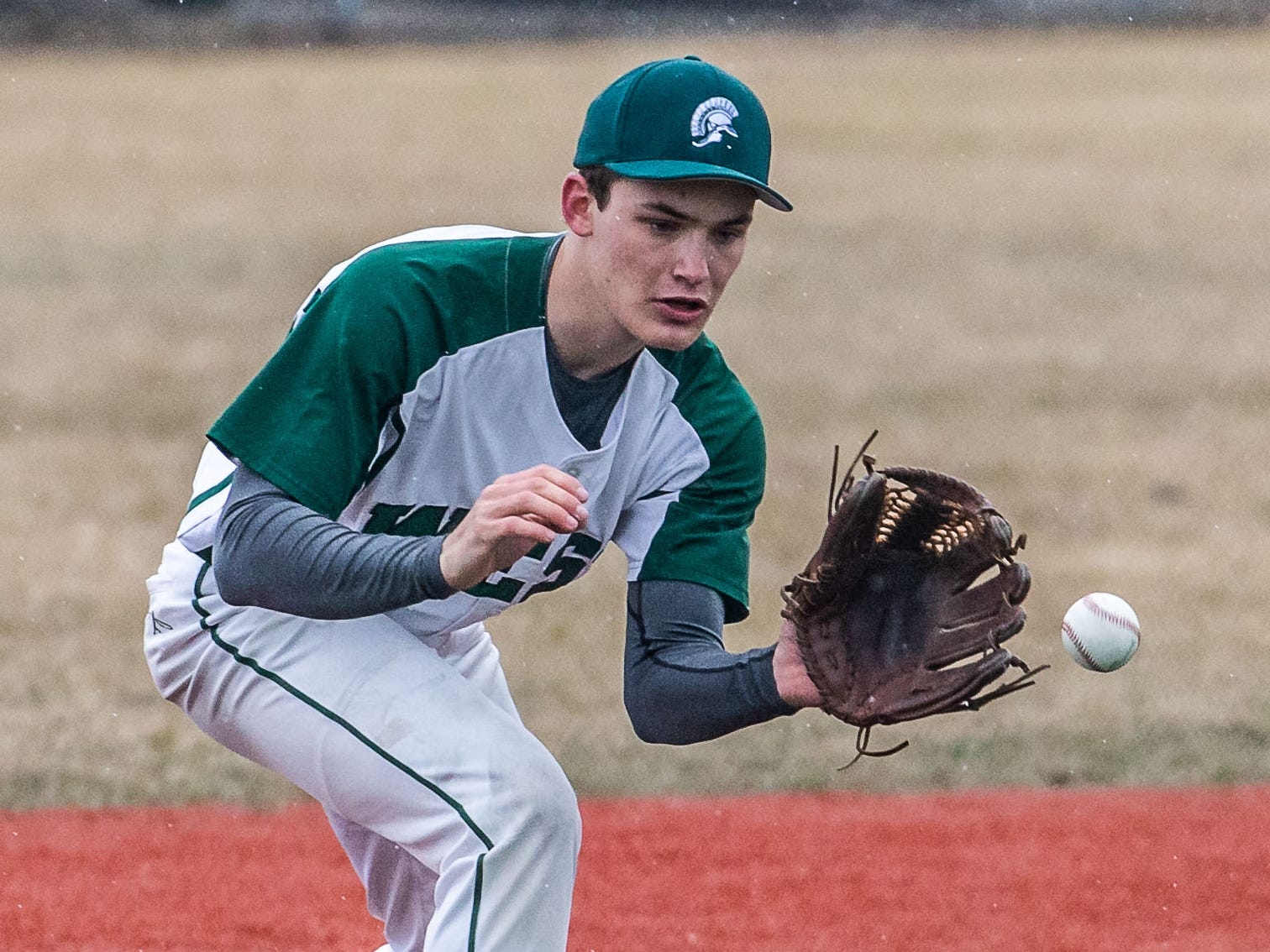 Wauwatosa West third baseman James Lee (2) takes one on the hop during the game at Brookfield Central on Thursday, April 4, 2019.