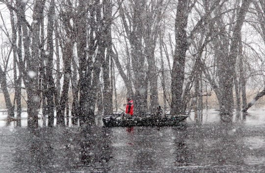 An April Fool's squall drives snowflakes across the Wolf River.