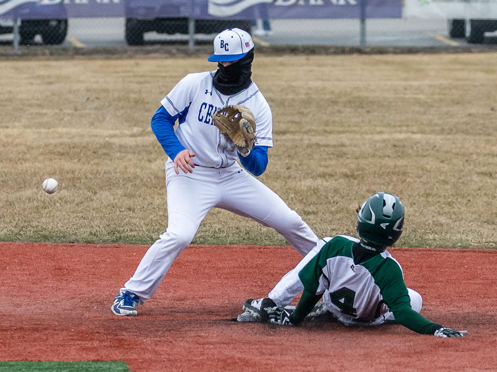 Wauwatosa West's Colton Scharf (4) steals second base as Brookfield Central shortstop Sal Gambatese waits on the throw at Brookfield Central on Thursday, April 4, 2019.