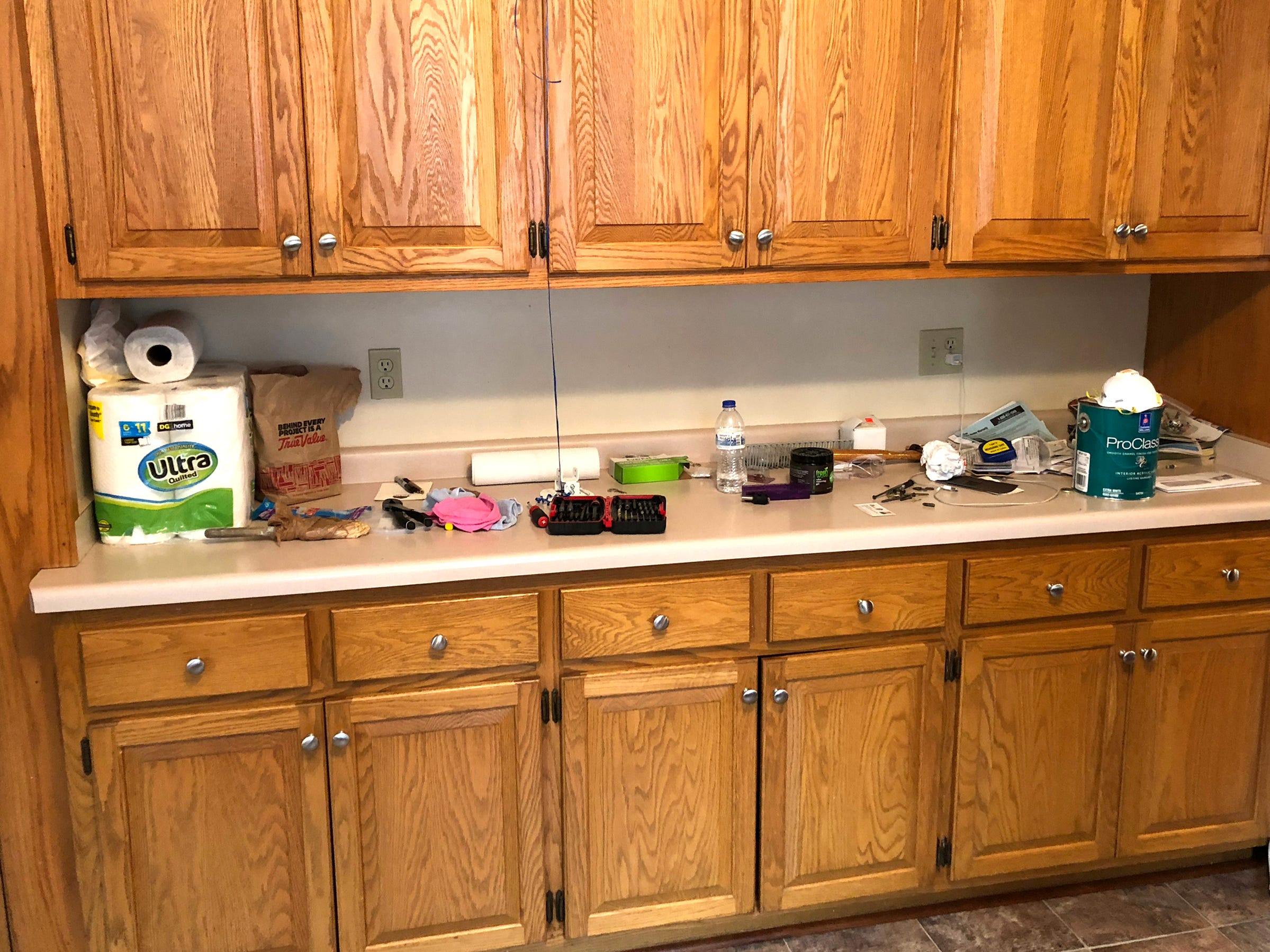 """This homeowner called on Junk Wives Wisconsin to update the look of her kitchen, leaving the countertops and flooring intact. Here is the """"before"""" photo."""