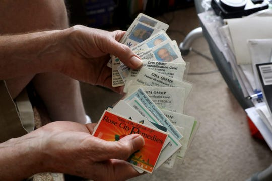 Madison resident Gary Storck shows out-of-state medical marijuana cards and marijuana-related memorabilia. Storck uses the cards under an obscure Wisconsin law that allows patients to have a controlled substance with a valid prescription or order from a doctor. Storck uses cannabis to relieve the symptoms of glaucoma.