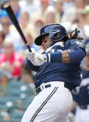 Milwaukee Brewers second baseman Rickie Weeks (23) hits a single during the sixth inning of their game against the San Francisco Giants Thursday, August 7, 2014 at Miller Park in Milwaukee, Wis.