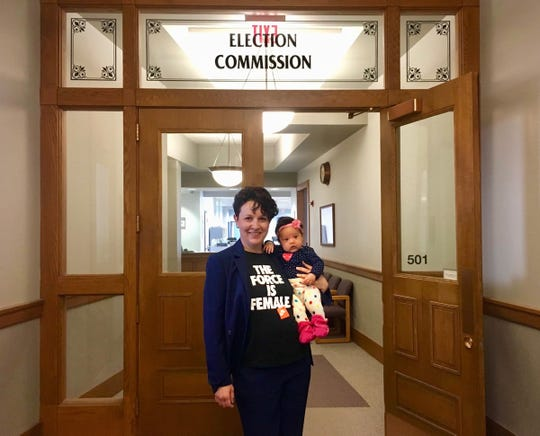Marina Dimitrijevic, seen here holding her infant daughter, filed to run for alderwoman representing Milwaukee's 14th District at City Hall today. April 5, 2019.