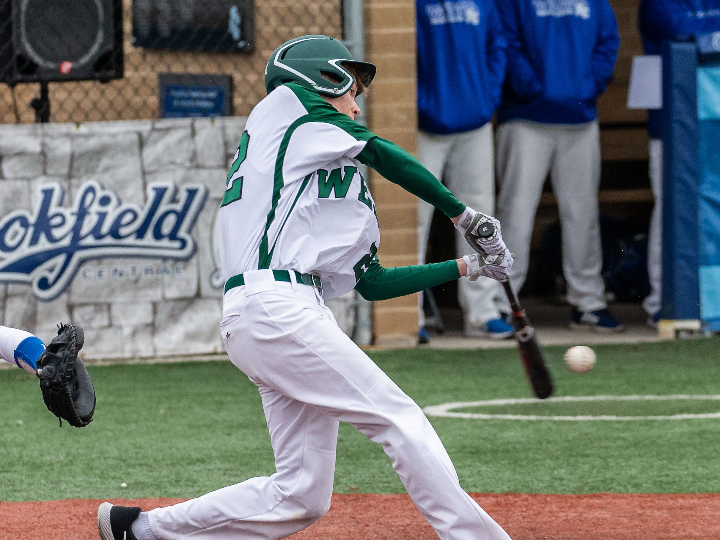 Wauwatosa West's Mitch Fassbender (22) connects during the game at Brookfield Central on Thursday, April 4, 2019.