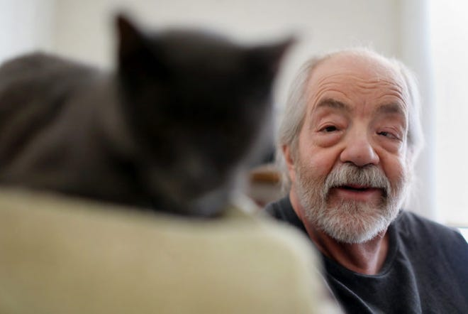 Madison resident Gary Storck has suffered from glaucoma since he was a child. When he was a teenager, Storck read that marijuana could relieve the pressure and pain in his eyes and he has been using it as a medicine ever since. He is seen in his apartment in Madison with his cat, Roy, on March 20.