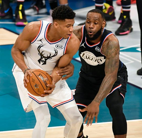 Team Giannis' Giannis Antetokounmpo, of the Milwaukee Bucks, challenges Team LeBron's LeBron James, of the Los Angeles Lakers, during the 2019 NBA All-Star 2019 game, February 17, 2019. He scored 38.