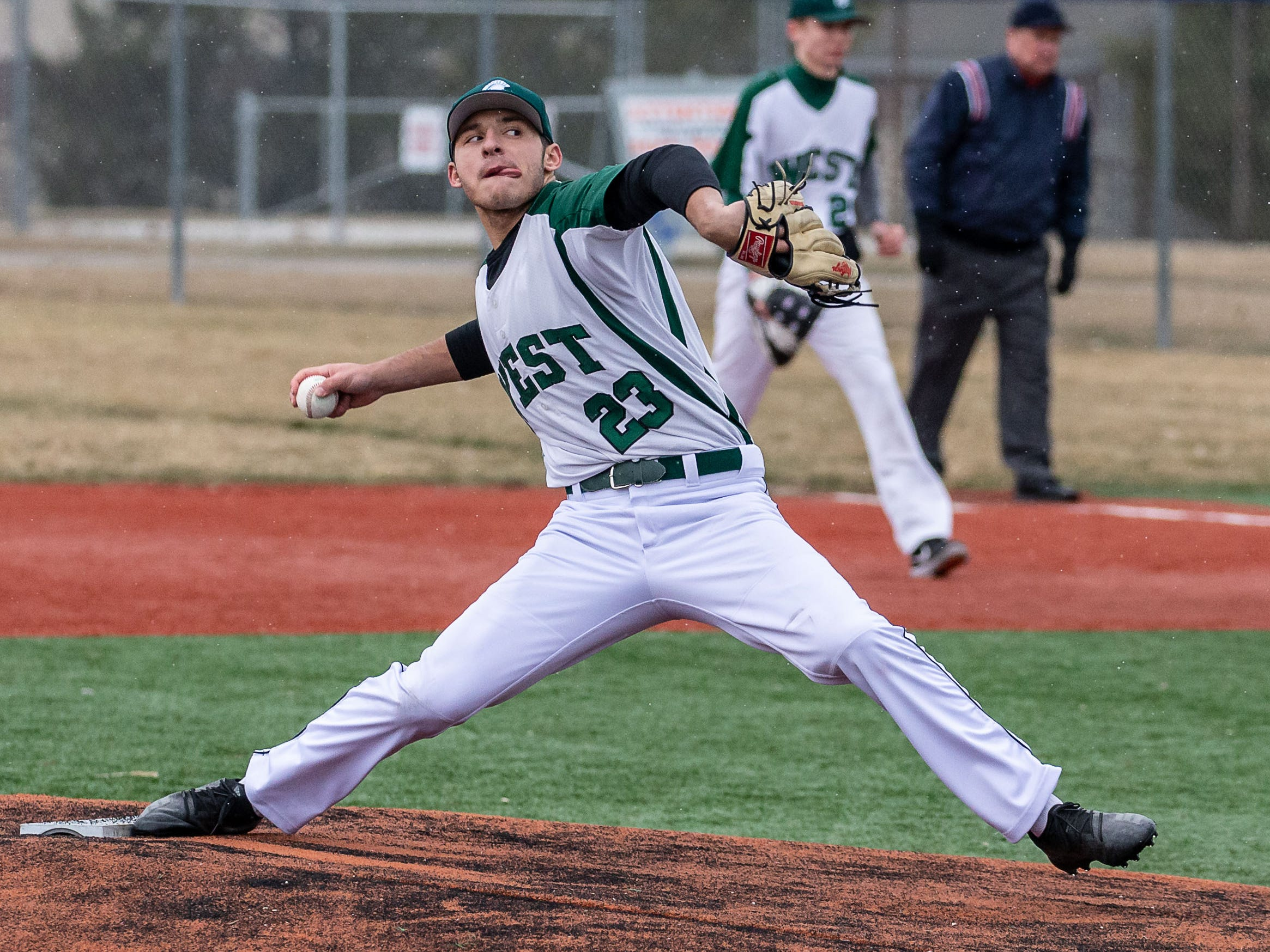 Wauwatosa West pitcher Spencer Whitlock (23) winds up during the game at Brookfield Central on Thursday, April 4, 2019.