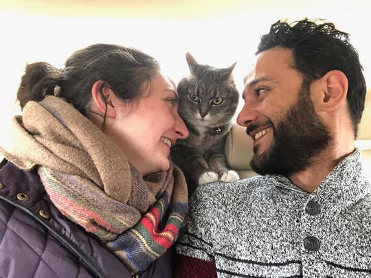 Wauwatosa residents Emily Hendricks and her fiancé, Ahmed Abu Seif, look lovingly at their cat, Kiki. The cat went missing after a fire on April 1. She was found a few days later.