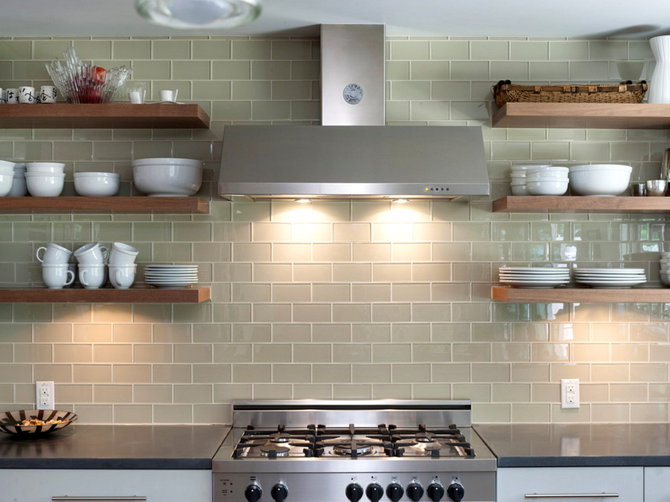 With open shelves, a tile backsplash can extend all the way up to the ceiling.