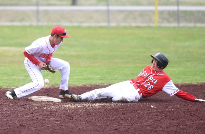 Norfork's Jaden McFall slides into second base as Flippin's Preston Belding attempts to handle the throw Thursday night at Flippin.