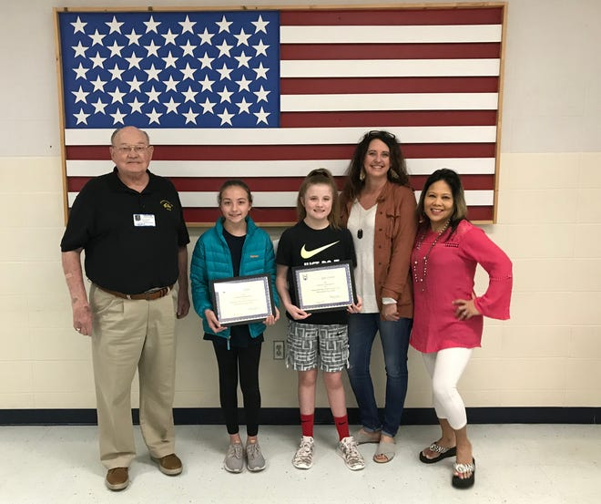 Local winners of the 2018-2019 Arkansas State Elks Americanism Essay Contest were recently honored during an awards assembly at Pinkston Middle School. Sixth-grade winners were: Ella Hilvert, who took first in the state certificate and won $200; and Rylee Crecelius, was third in the state certificate and won $100. Their essays were chosen from over 270 essays locally and then competed on a statewide level. Hilvert's essay will now go on to compete for national honors. This is the fifth consecutive year that Pinkston Middle School students have won the state contest. Pictured are: (from left)Stuart Friend, Elks president; Ella Hilvert; Rylee Crecelius; Vonya Schaufler, sixth-grade teacher and Mountain Home Elks Americanism chairman; and Mylet Trotter, Literacy teacher. Not pictured: Melanie Kelly Literacy teacher.