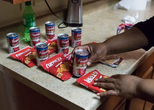 Shevonda Marshall, a direct care worker, lays out the afternoon snacks for the residents at the G.B. Cooley Shannon House in Monroe, La. on April 5. The parishwide organization operates community homes in the area which provides round-the-clock care to persons with intellectual disabilities