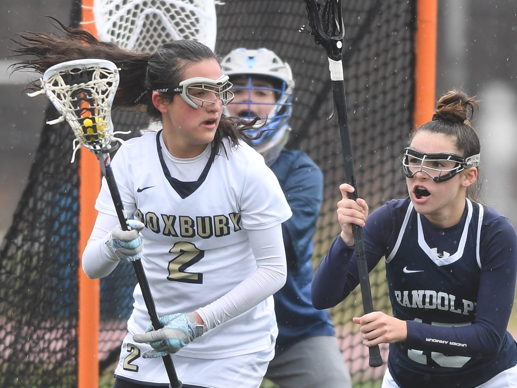 Randolph girls lacrosse at Roxbury on Friday, April 5, 2019. Roxbury  #2 Emily Stanich and Randolph #15 Kiara Iannacconi.