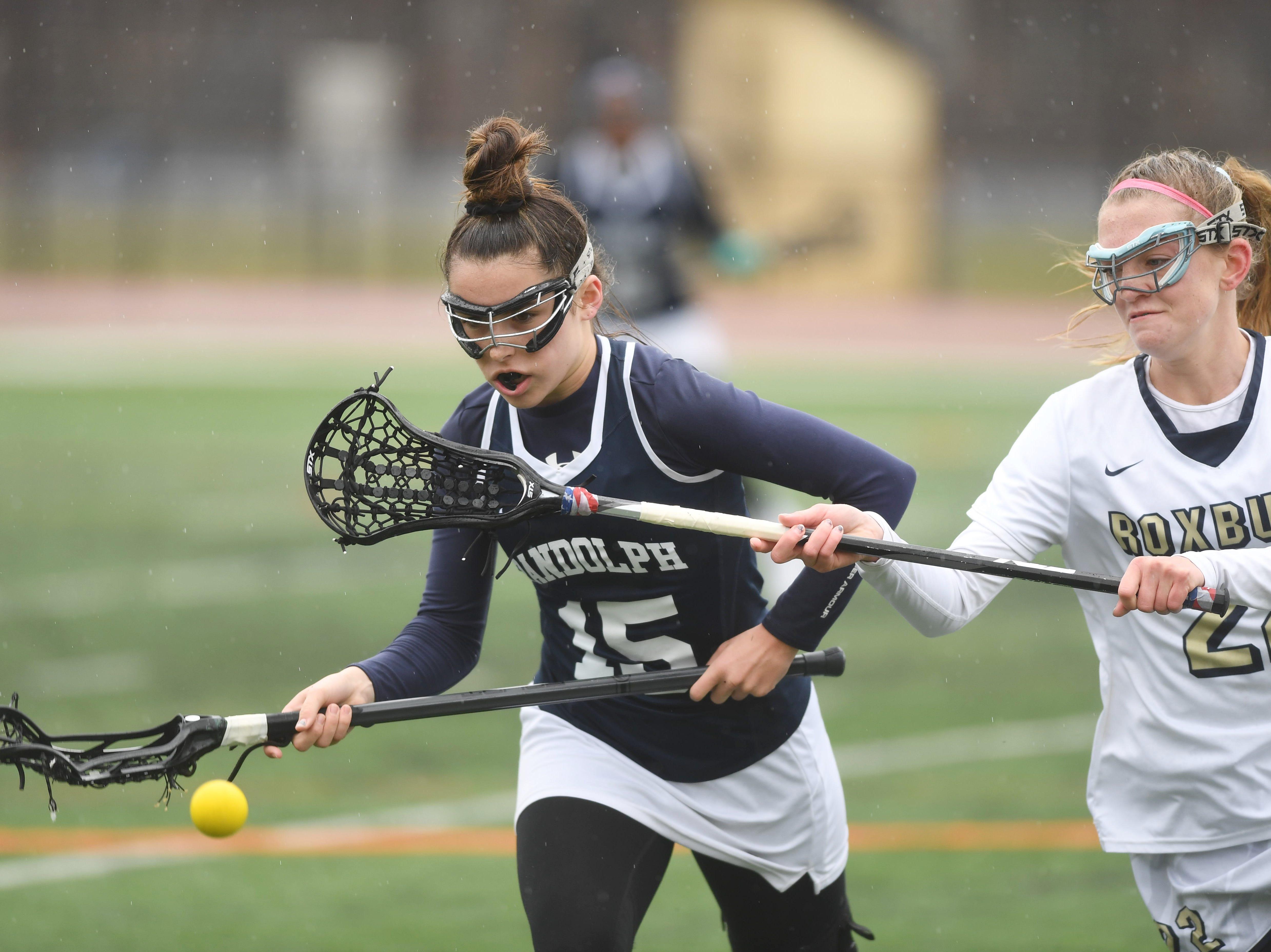 Randolph girls lacrosse at Roxbury on Friday, April 5, 2019. Randolph #15 Kiara Iannacconi and Roxbury #22 Lauren Ernst.