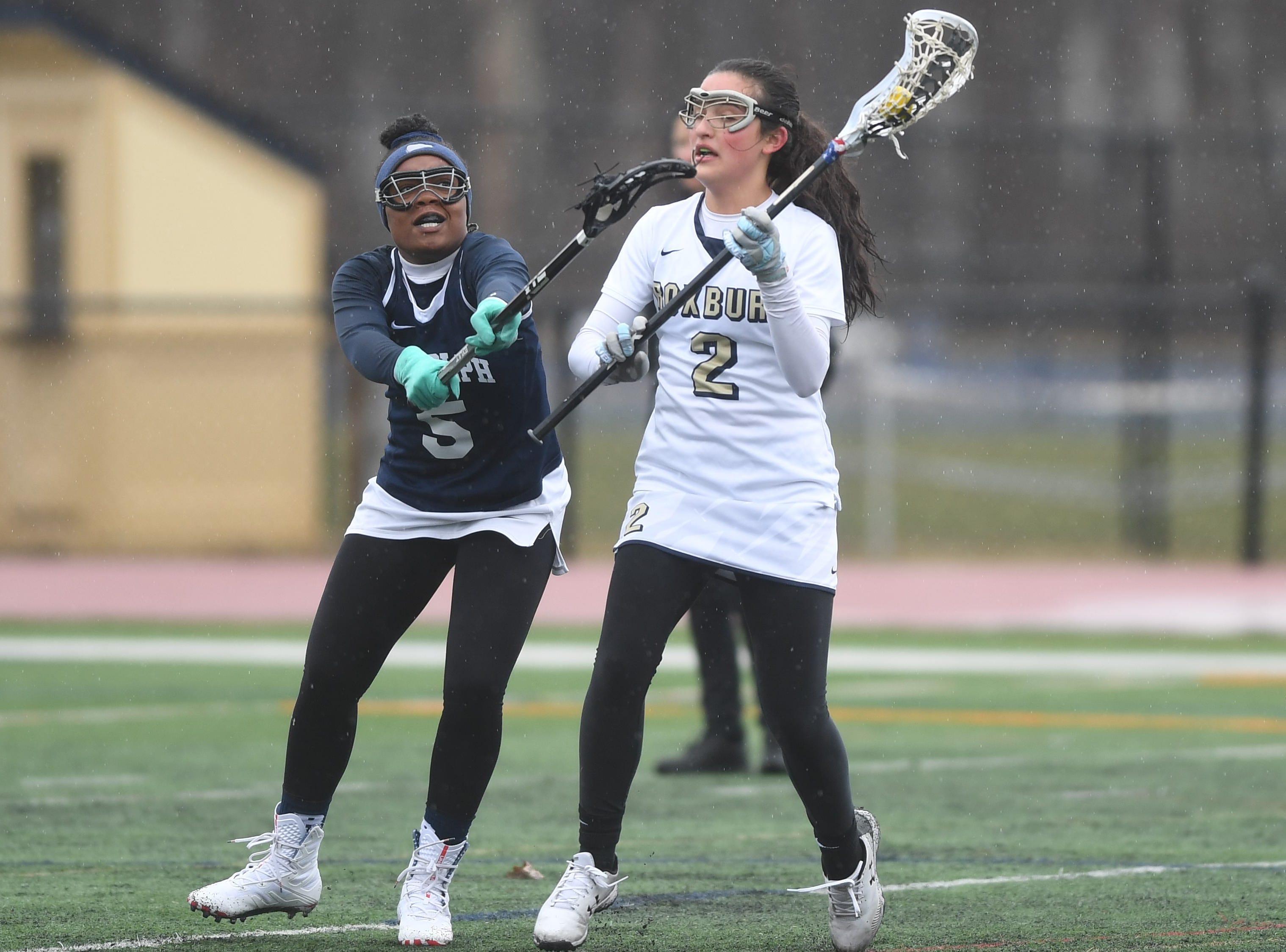 Randolph girls lacrosse at Roxbury on Friday, April 5, 2019. Roxbury  #2 Emily Stanich and Randolph #5 Kristine Lynch.