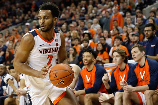 Virginia's Braxton Key (2) drives to the basket against the Louisville Cardinals at John Paul Jones Arena on March 9, 2019, in Charlottesville, Va.