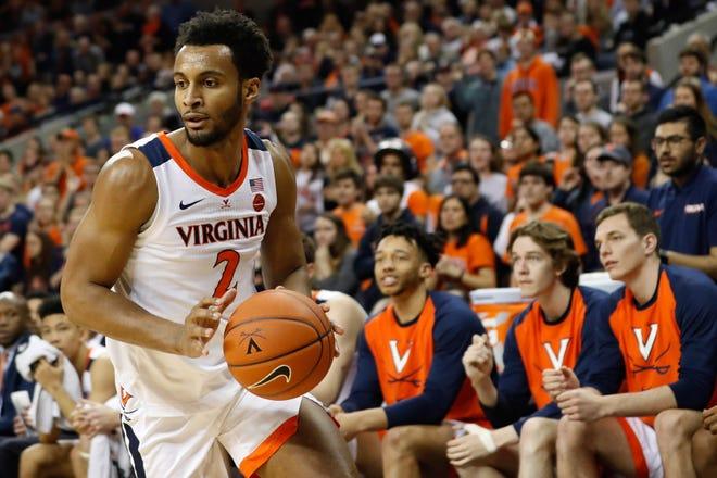 Virginia's Braxton Key (2) drives to the basket against the Louisville Cardinals at John Paul Jones Arena on March 9, 2019, in Charlottesville, Va.