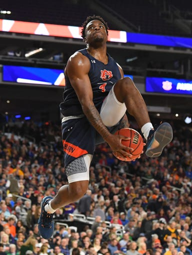 Apr 5, 2019; Minneapolis, MN, USA; Auburn Tigers guard Malik Dunbar (4) attempts a shot during practice for the 2019 men's Final Four at US Bank Stadium. Mandatory Credit: Robert Deutsch-USA TODAY Sports