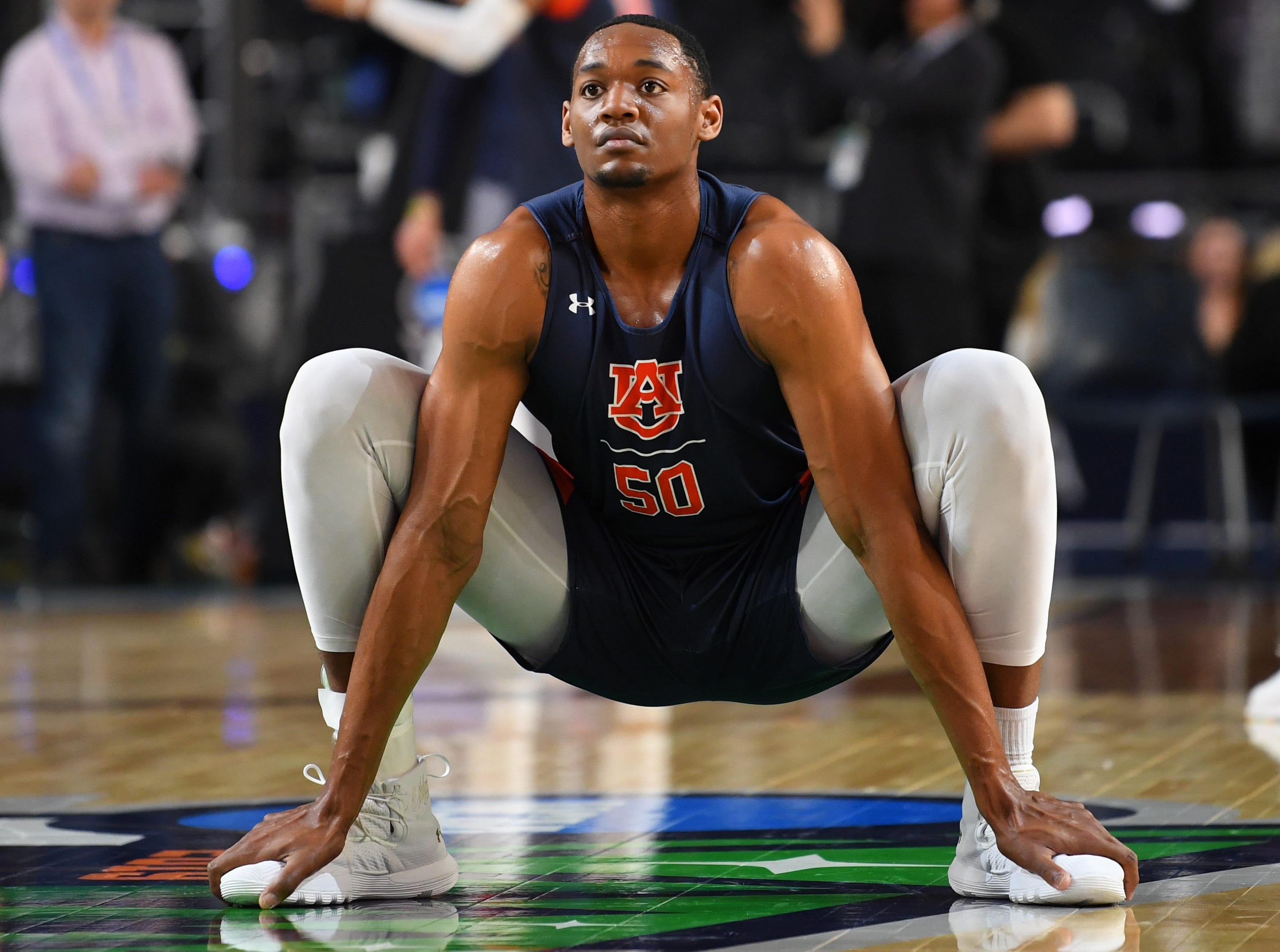 Apr 5, 2019; Minneapolis, MN, USA; Auburn Tigers center Austin Wiley (50) stretches during practice for the 2019 men's Final Four at US Bank Stadium. Mandatory Credit: Bob Donnan-USA TODAY Sports