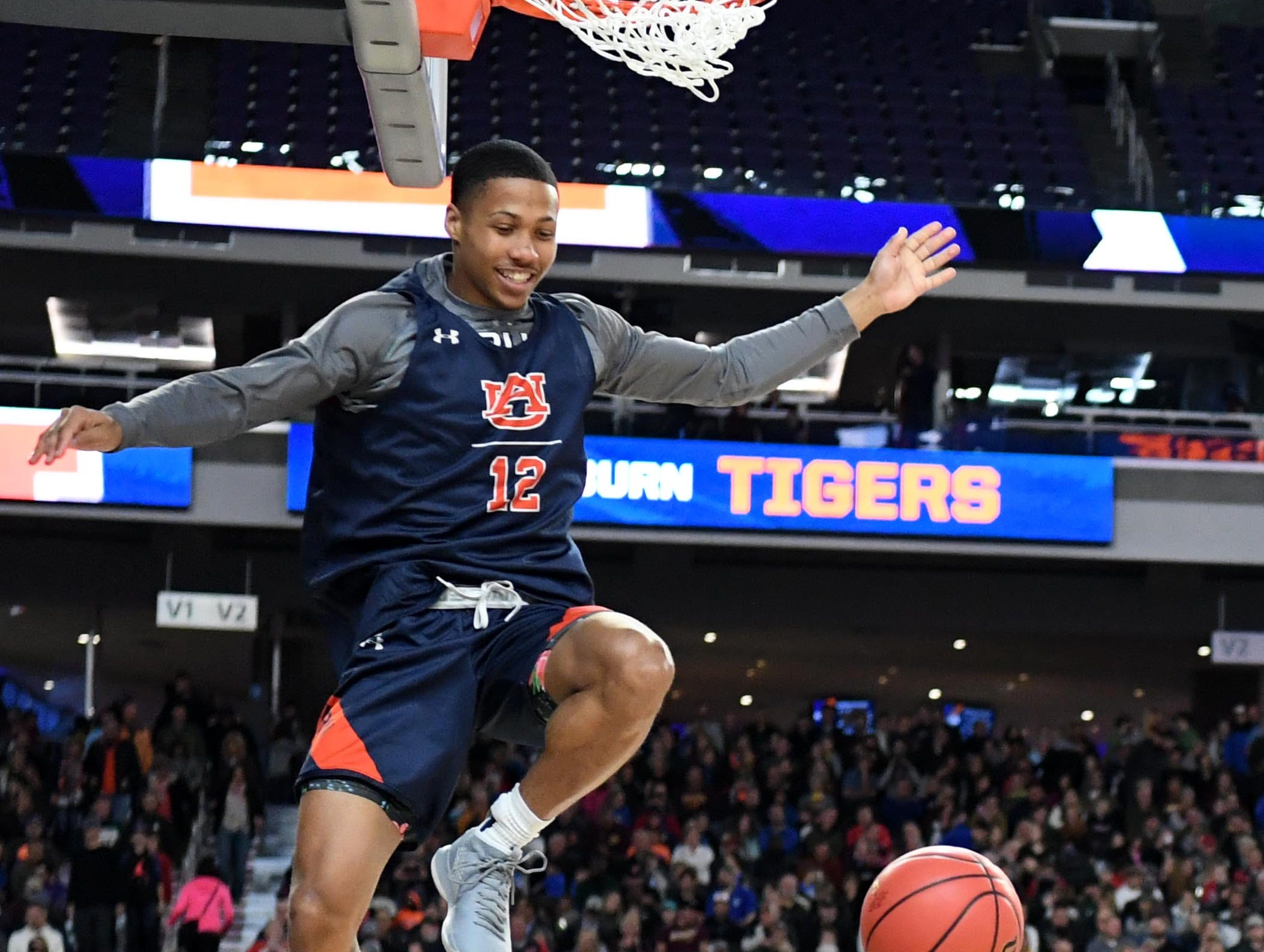 Apr 5, 2019; Minneapolis, MN, USA; Auburn Tigers guard J'Von McCormick (12) dunks during practice for the 2019 men's Final Four at US Bank Stadium. Mandatory Credit: Robert Deutsch-USA TODAY Sports