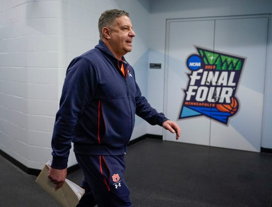 Auburn head coach Bruce Pearl walks to a news conference after a practice session at the Final Four on Thursday, April 4, 2019, in Minneapolis.