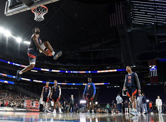 Auburn guard Malik Dunbar (4) attempts a dunk during practice before the Final Four at U.S. Bank Stadium on Friday, April 5, 2019, in Minneapolis.