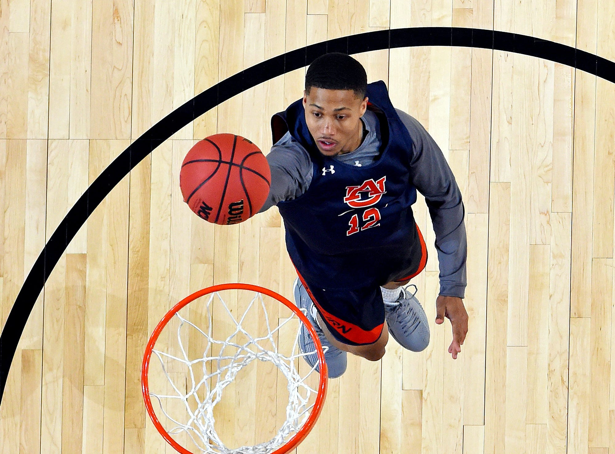 Apr 5, 2019; Minneapolis, MN, USA; Auburn Tigers guard J'Von McCormick (12) shoots the ball during practice for the 2019 men's Final Four at US Bank Stadium. Mandatory Credit: Bob Donnan-USA TODAY Sports