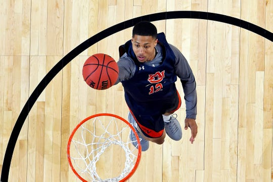 Auburn guard J'Von McCormick (12) shoots the ball during practice at the Final Four on April 5, 2019, in Minneapolis.