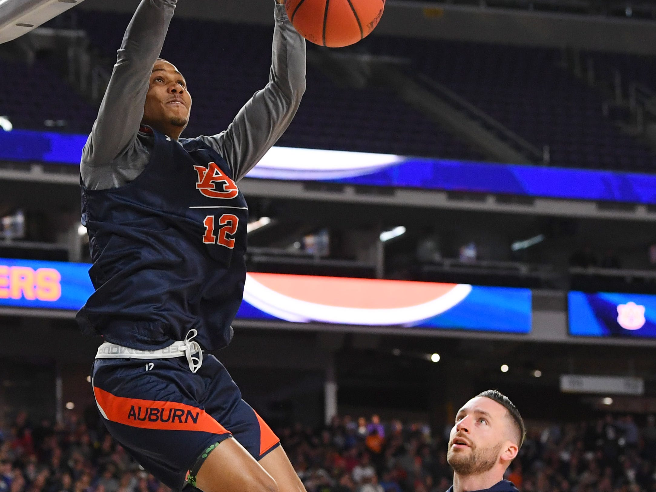 Apr 5, 2019; Minneapolis, MN, USA; Auburn Tigers guard J'Von McCormick (12) dunks th eball during practice for the 2019 men's Final Four at US Bank Stadium. Mandatory Credit: Robert Deutsch-USA TODAY Sports